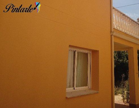 Fachada lateral pintada con procotex color albero en Otero (Toledo)